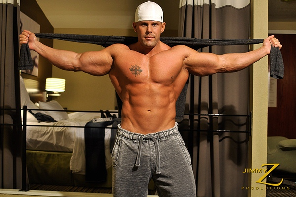 Hot muscle hunk Connor Stewart flexing, posing and showing off his big cock in Overnight Pt. 2 at Jimmyzproductions