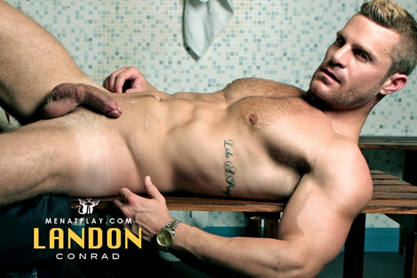 Handsome muscular Landon Conrad strokes his big cock and busts his nuts at Menatplay