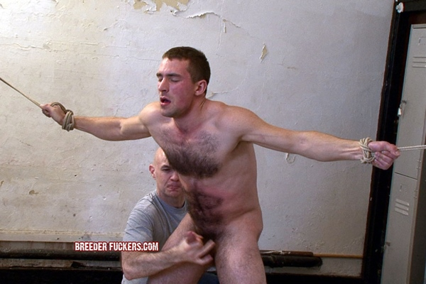 Guy Rogers gets tied, spanked, punched, kicked and forced to cum at Breederfuckers