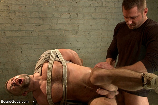 Brutal master Andrew Justice tortures and fucks a big load out of muscular Dirk Caber in The Terrorist's Ransom at Boundgods