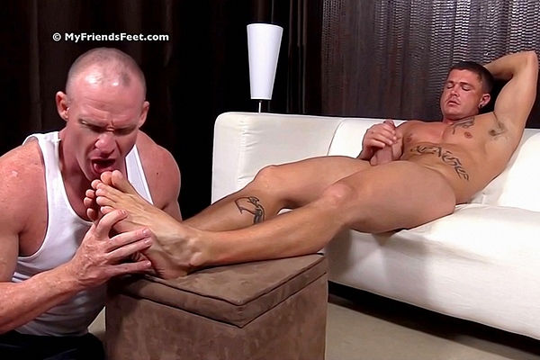 Sexy muscle jock Sebastian Young cums while getting his size 12 feet worshiped at Myfriendsfeet