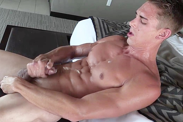 Hot athletic jock Austin Anderson strokes two big thick loads out of his hard cock in The Ripped Gym Stud at Gayhoopla