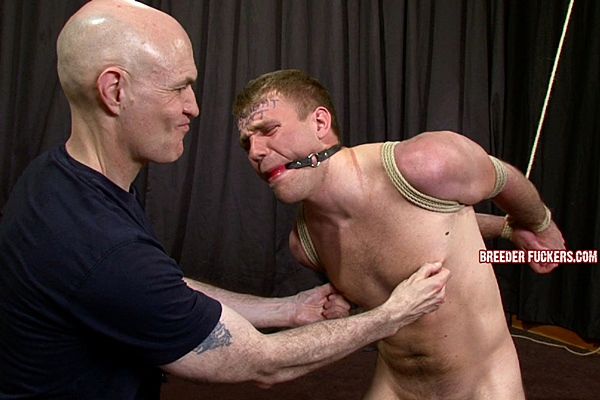 Hot cage fighter John gets tied up, gagged, humiliated, dildo-fucked by master Adrian and Dave at Breederfuckers