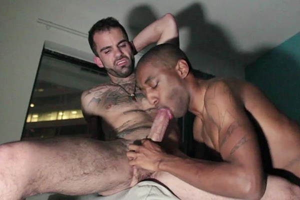 Rogan Hardy Deepthroats big-dicked inked dude Devin Chase before he jerks Devin off at Harlemhookups