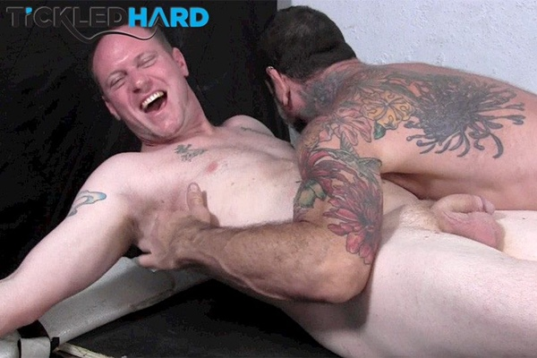 Beefy straight guy Roger gets his cummy feet tickled by Franco Dax at Tickledhard