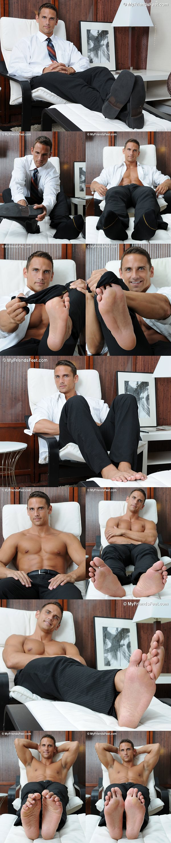 Handsome businessman Cody's size 12 feet and dress socks at Myfriendsfeet