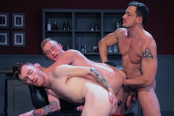Joey D fists Seamus O'Reilly and Colin Bryant in Fisty's Barber Shop at Fistingcentral