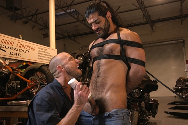 Hot Arab biker Ali Liam gets edged by Jessie Colter in the motorcycle garage at Menonedge