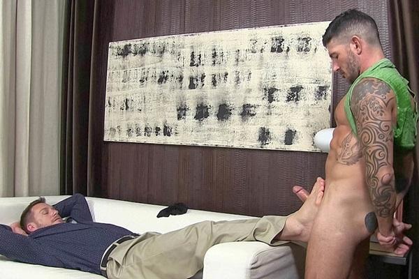 Inked stud Johnny Hazzard fucks Hans Berlin's socks and bare feet until he cums at Myfriendsfeet