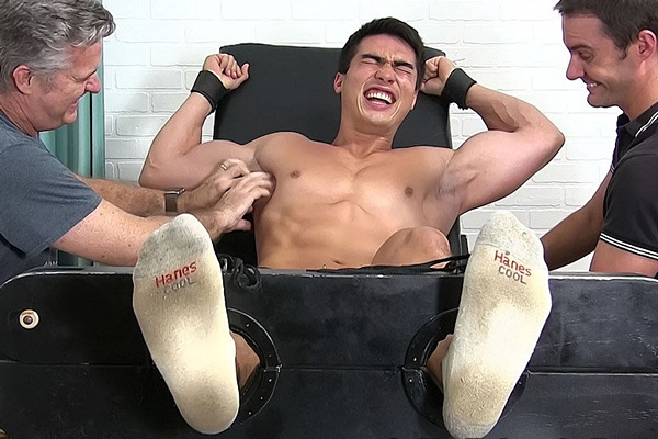 Brunette straight muscle jock Axel Kane tickled naked at Myfriendsfeet