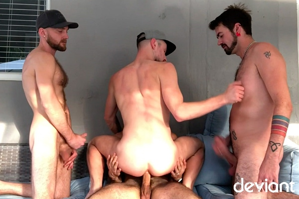 Kai Davis, Deviant Otter and Deviant Otter's Pup bareback Drew Dixon before Kai fucks the cum out of Drew in Behind The Smut British Invasion at Deviantotter