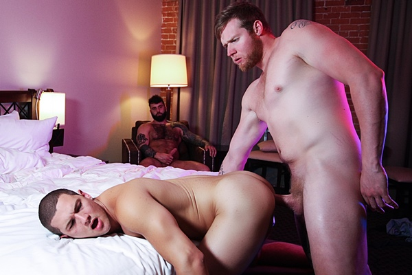 Bearded macho top Ryan Stone barebacks hung muscle jock Jay Dymel while MMA fighter Markus Kage jerks off himself in Friendly Fire, Part 1 at Masqulin