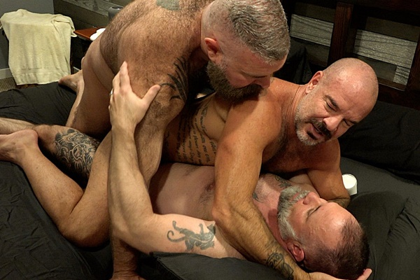 Hairy muscle daddy Will Angell barebacks inked muscle bear Jack Dyer and Liam Angell before he creampies Jack in a threeway in Monkey Business at Musclebearporn