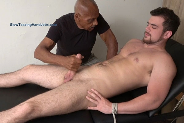 Masculine straight muscle stud Dan gets tied up naked, slowly sucked and jerked off by master Chic at Slowteasinghandjobs