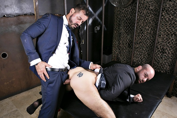 Hot daddy Thomas Thunder barebacks bald masculine stud Bruno Max's tight bubble ass before he fucks a big load out of Bruno in Cruising Glory Hole at Menatplay