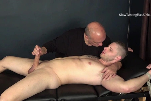 Master Rich fondles, slowly strokes and sucks hot inked straight beefcake Brad's cock until Brad nuts in Rich's mouth in Brad Slowly Sucked Off at Slowteasinghandjobs