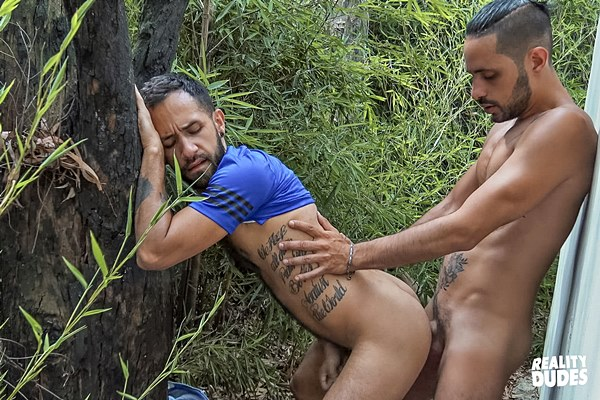 Real life couple Milo and Julio take turns barebacking each other outdoors before the long-haired hottie fucks the cum out of his man and cums in his mouth at Realitydudes