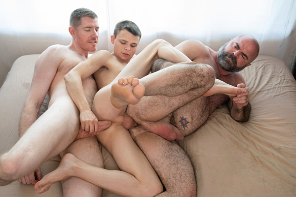 Big-cocked daddy LeGrand Wolf barebacks Austin Young and Bishop Angus before Austin and Angus get creampied in an older younger threesome in Austin's Team Play at Twinktop