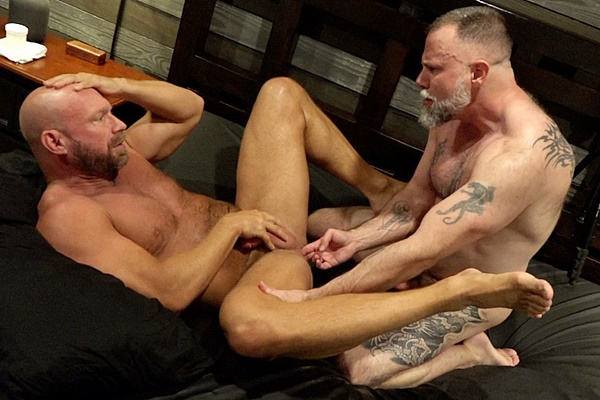 Inked muscle bear Liam Angell barebacks masculine bald daddy Killian Knox before he creampies Killian in Feeding Daddy Some Boy Load at Musclebearporn