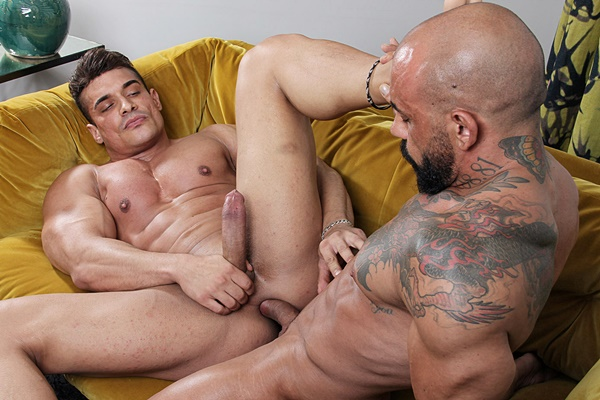 Inked gay porn star Juanjo Rodriguez barebacks Spanish bodybuilder Heracles before he finger-fucks the cum out of Heracles in Heracles' bottoming debut in Casting Couch 434 at Kristenbjorn