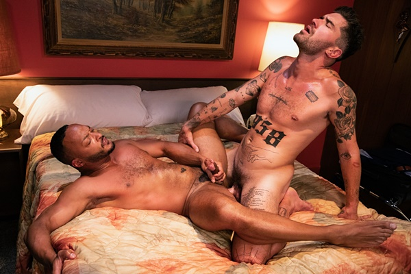 Handsome inked stud Chris Damned barebacks black muscle hunk Dillon Diaz in an interracial scene before he breeds Dillion at Ragingstallion