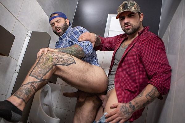 Manly Canadian beefacke Ryan Bones barebacks tattooed hairy muscle stud Markus Kage in the bathroom before he fucks the cum out of Markus in Truck Stop at Bromo