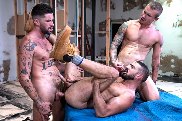 Handsome inked porn star Chris Damned barebacks Marco Napoli and Isaac X in a threesome before Marco and Chris creampie and fuck the cum out of Isaac in Caulk Job at Ragingstallion