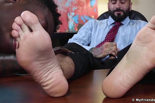 Hunky newcomer, black muscle stud Marcel Eugene worships porn star Rikk York's dress socks and bare feet till he cums in Marcel's Job Interview at Myfriendsfeet