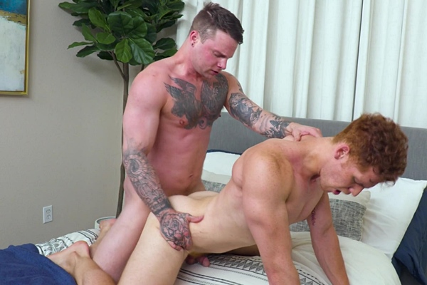 Tattooed muscle stud Tyler James barebacks fit redhead newcomer Chris White in several positions before he breeds Chris in Chris' bottoming debut at Stagcollective