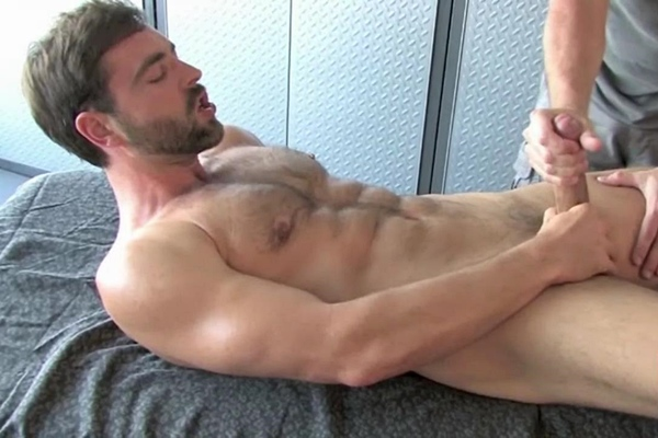 Sexy hairy straight hunk, male model Thomas (aka Tom Woodson) gets massaged by a masseur before the masseur jerks a sticky load out of Thomas' hard boner at Legendmen