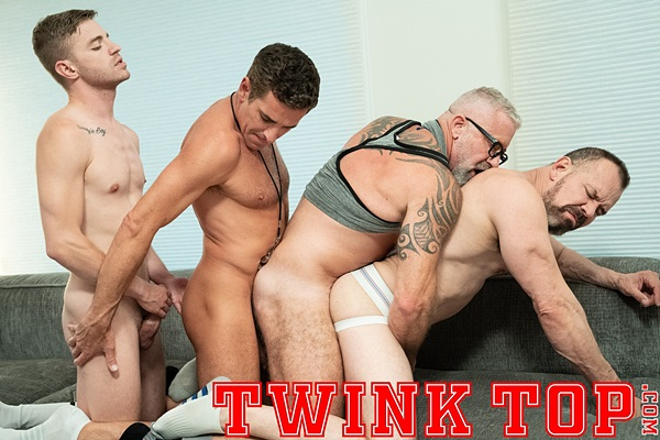 Twink Tom Bentley barebacks muscle daddies Principal Ballard (aka Max Sargent), Mitch Cox and Lance Charger in an older younger foursome in Tag Team at Twinktop